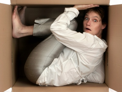 cramped lady in moving box