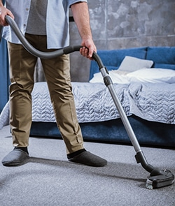 cleaning the bedroom